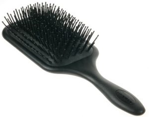 a photo of a paddle brush by Denman